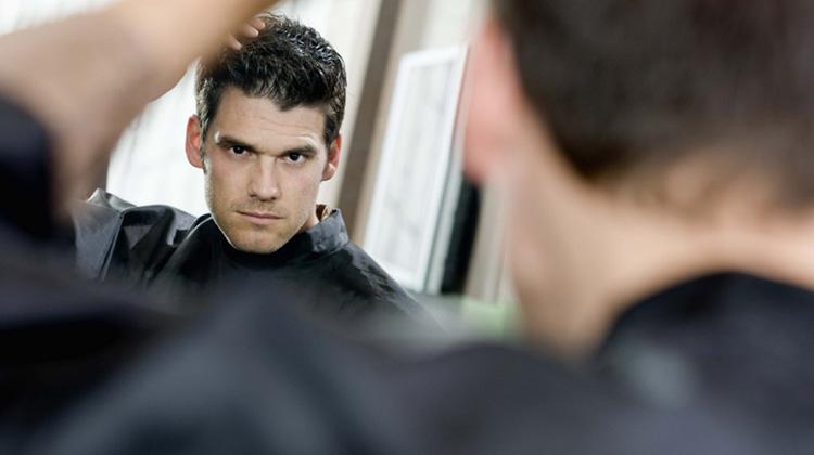 120123022008-narcissism-man-looking-mirror-ego-horizontal-large-gallery